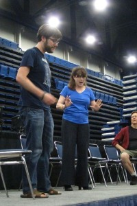 Onstage with Richard Hatch and another audience member doing improv
